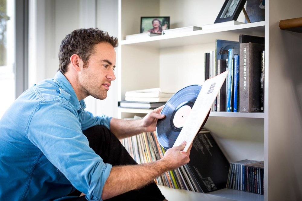 Guy Looking At Record Collection