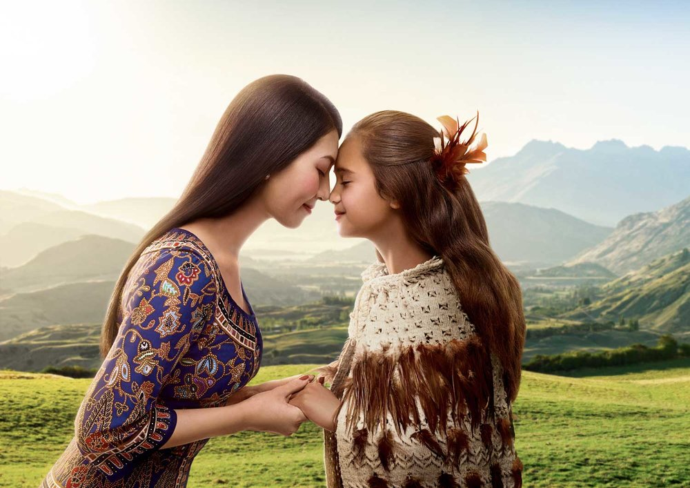 Singapore Airlines Young Woman and Maori Girl Hongi