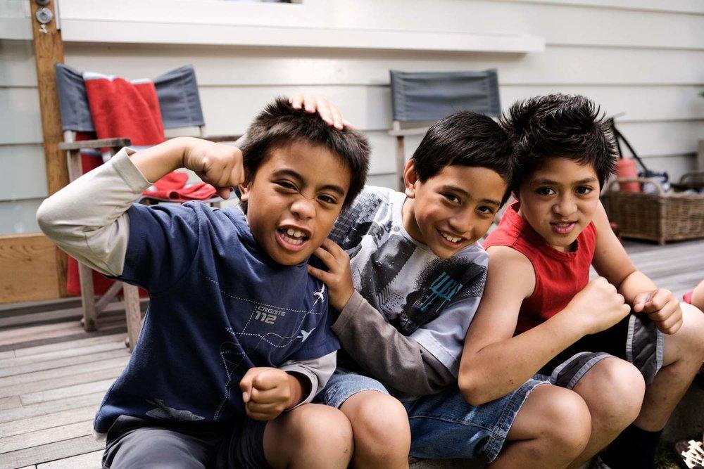 Three young Maori boys Flexing