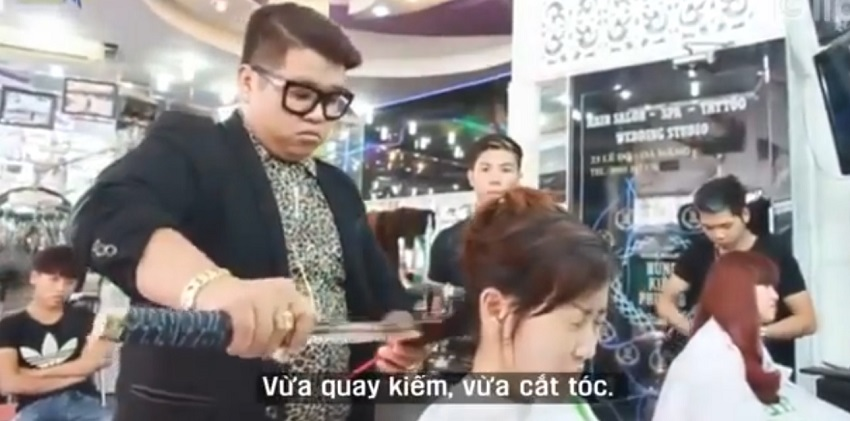Vietnamese hair stylist Nguyen Hoang Hung is approaching heads with sword in hand.