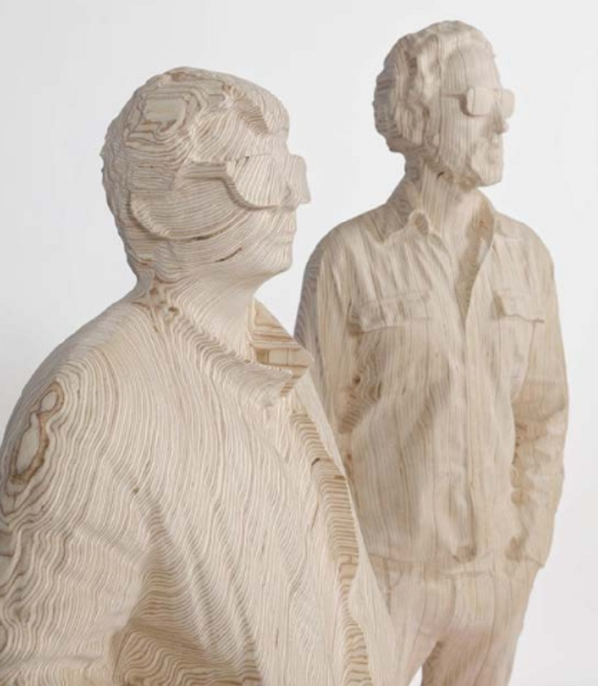 The faces of musical duo Daft Punk revealed in 3D sculpted birch plywood.
