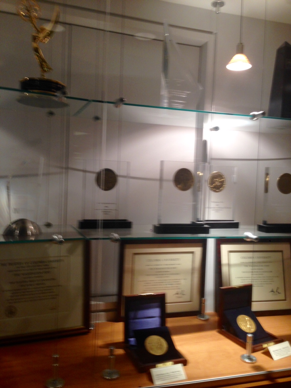 Just one slice of the Great Wall of Awards... Spot the Emmy? The Pulitzer? #dreams
