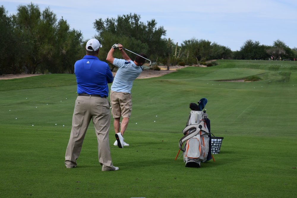 Jeff Yurkiewicz helps instruct a student during a half day golf school at Grayhawk Golf Club in Scottsdale, AZ.