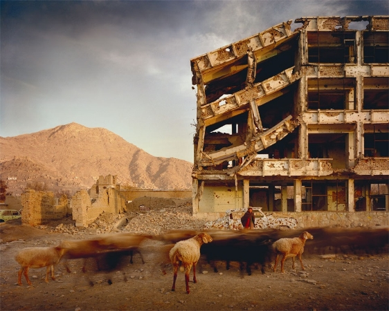 Bullet-scarred apartment building and shops in the Karte Char district of Kabul.This area saw fighting between Hikmetyar and Rabbani and then between Rabbani and the Hazaras,2003,by Simon Norfolk ©