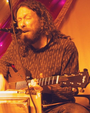 Peter Barratt - devotional musician and kirtan singer,  http://www.kirtanpete.co.uk/