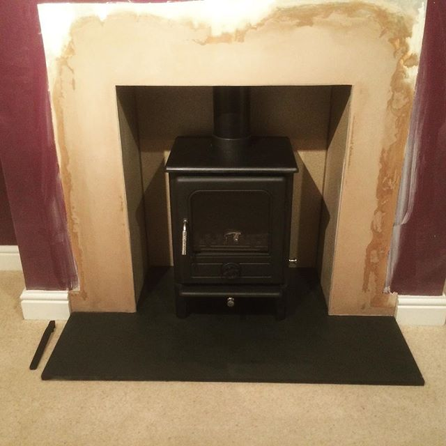 Stove installation with fireplace renovation with slate hearth ready to be decorated