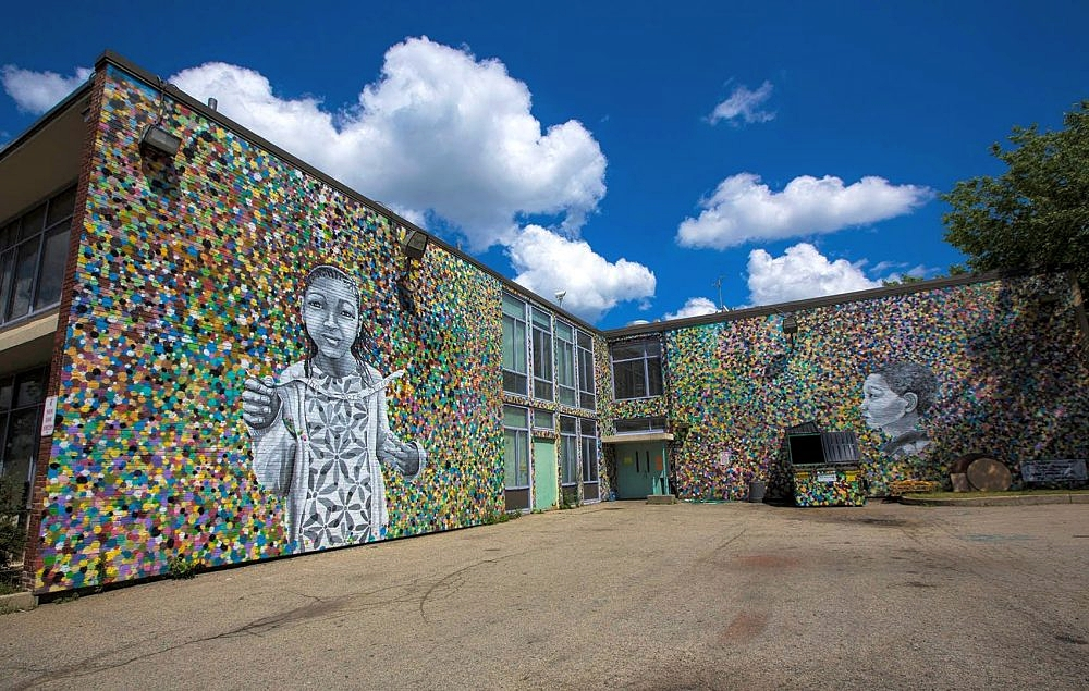 """The Work Begins"" mural by Katie Yamasaki and Caleb Neelon, Completed in 2014.  Photo Credit: Jesse Costa for  WBUR"
