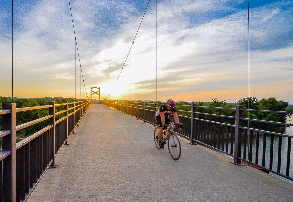 Bicyclist-on-pedestrian-bridge-Nashville.jpg