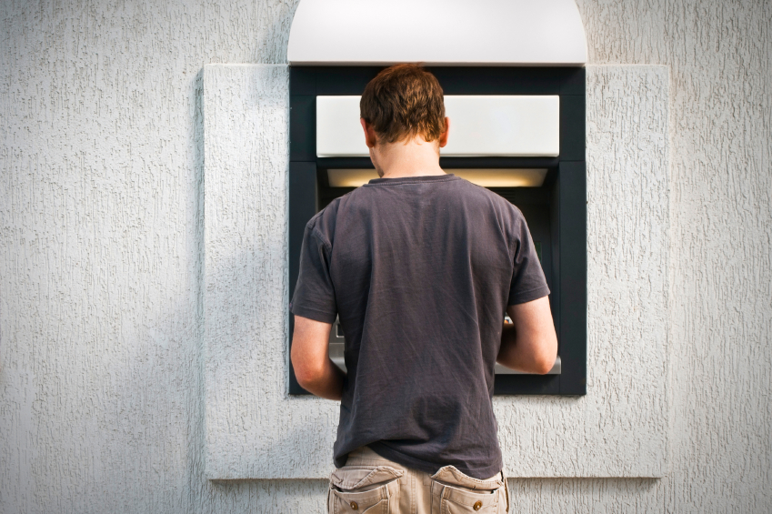 Man with Cell at ATM.jpg