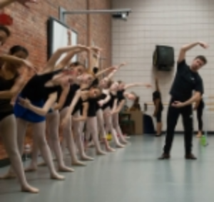 Carlos Lopez leads young dancers in a master class at Davidson School of Fine Arts. February 2015.