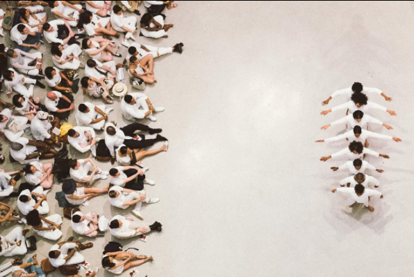 """Audience viewing """"An Ode To"""" [in all white, per Solange's request]."""