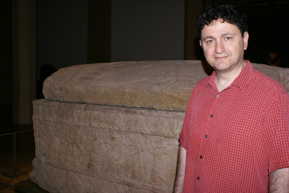 Author Michael Joseph Murano standing in front of the sarcophagus of King Ahiram, at the National Museum of Beirut, Lebanon.