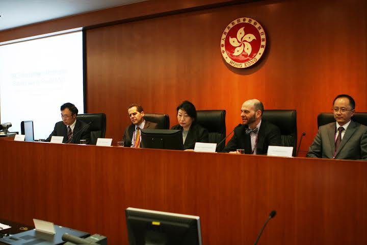 "Adam Pritchard (Michigan Law School) presents his paper ""Securities Law and its Enforcers"" to the ""General Issues of Legal Enforcement (2)"" panel as Zhang Xianchu (University of Hong Kong Law Faculty), Michael Barr (Michigan Law School and former Asst. U.S. Treasury Secretary), Hong Kong International Arbitration Centre Chairperson Teresa Cheng and Vice Chairman and Secretary General of the Shenzhen Court of International Arbitration Liu Xiaochun listen."