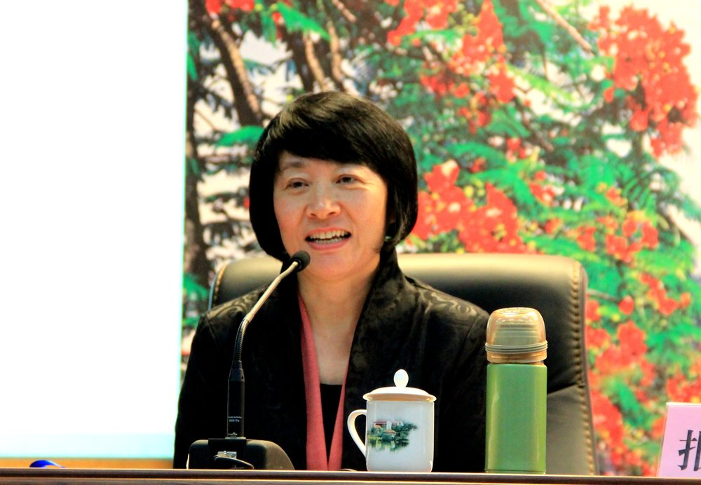 Professor Wang giving the keynote speech at a feminist conference in China