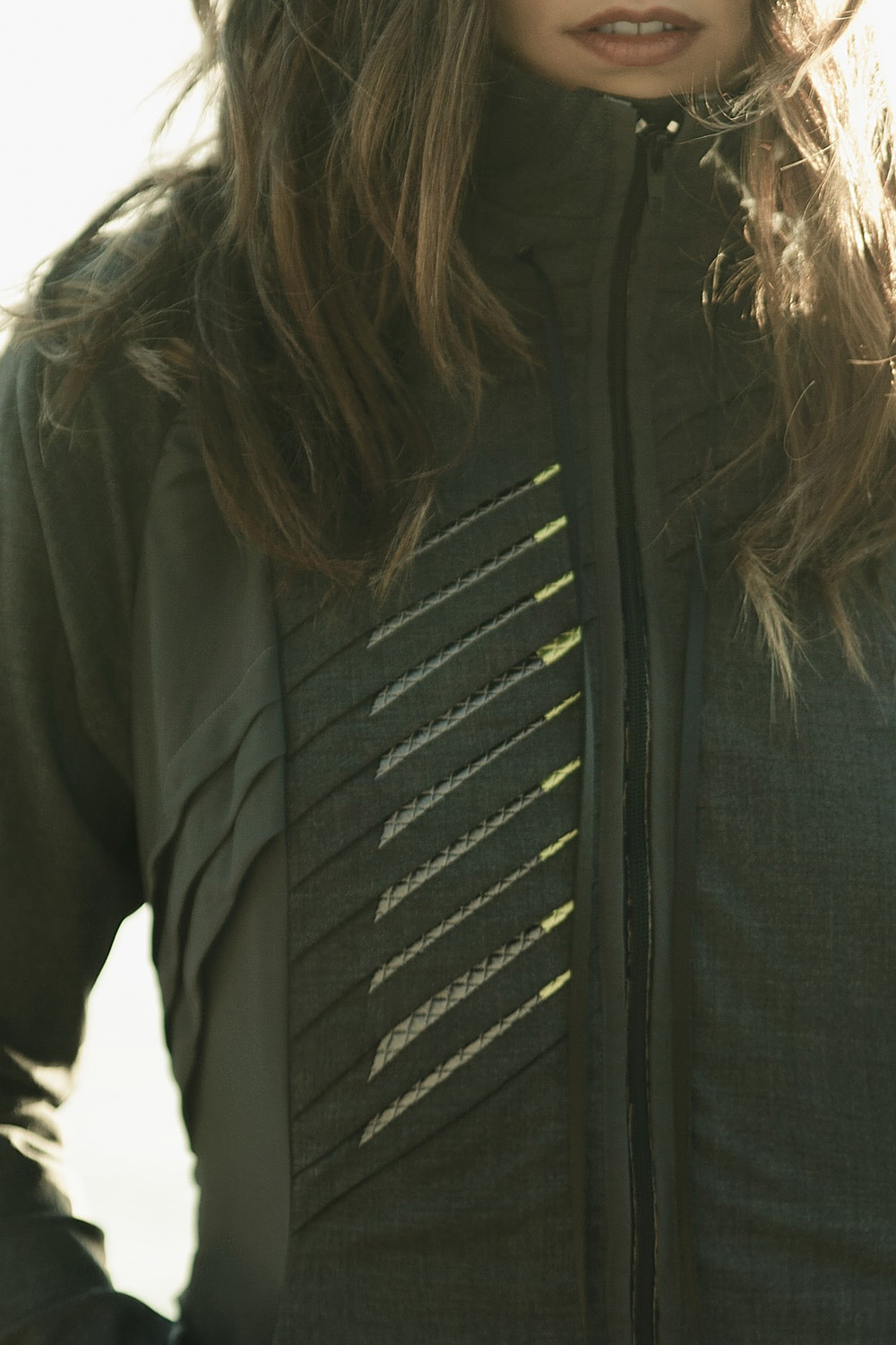 Functional Aesthetics The pleats are used as the main functional element of the garment that allow you to control the volume. Hard electronic components are replaced by embroidered etextiles that move and bend with your body in a way that is both functional and aesthetic.