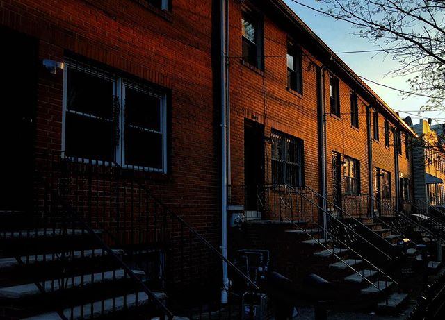 The sun setting on these brick home got me.