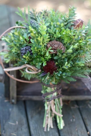 The boxwood cuttings in this bouquet compliment the flowers and berries tucked within.