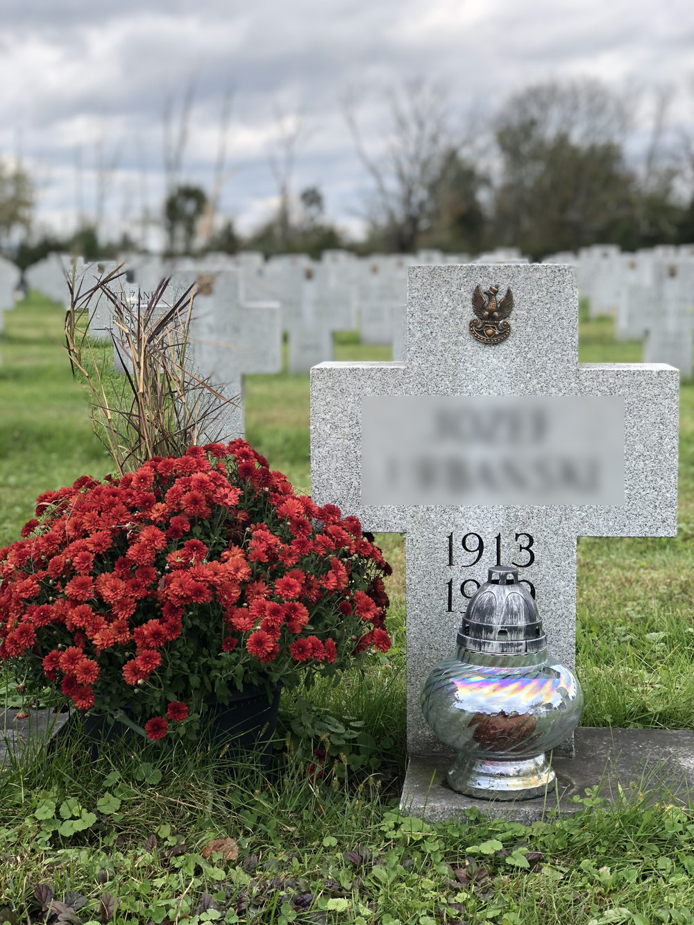 The All Saints' traditionally-decorated grave of a Polish soldier who fought in WWII at the Shrine of Our Lady of Czestochowa, Doylestown, PA.