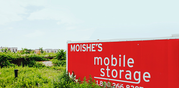 Moishe's mobile storage red sign and storage trailers