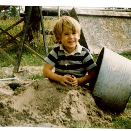 From front to back: sand, Chris, cement mixer, doghouse.  Strangely, that style of doghouse never caught on...
