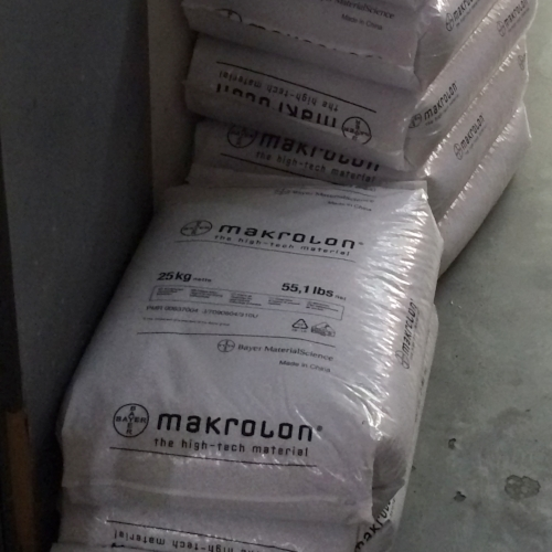 "These bags are full of Makrolon brand polycarbonate pellets. The pellets are melted to make the plastic ""goop"" that is injected into our molds."