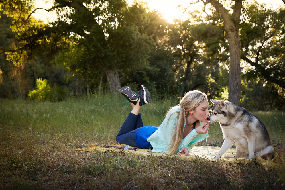 girl-with-dog-picnic-outdoor-bonding