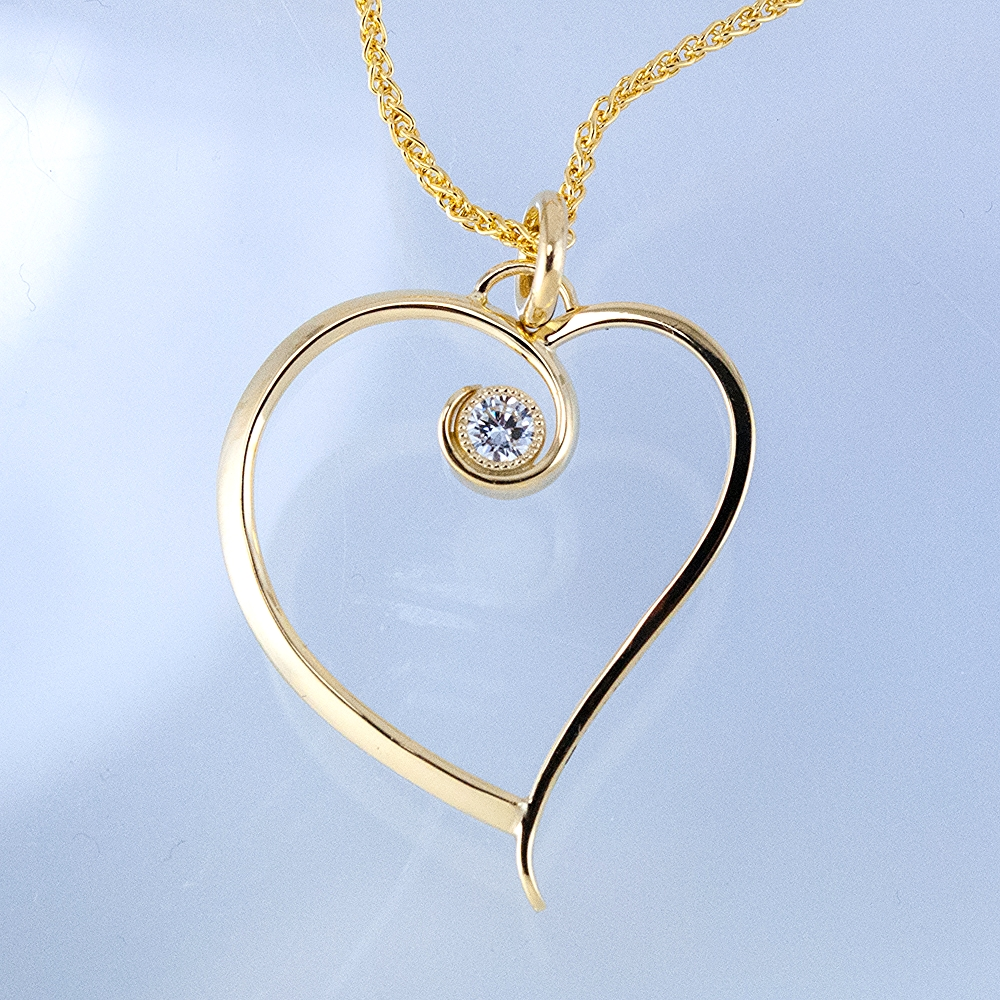 Large Asymetrical Forged Heart with 0.15 Carat Diamond