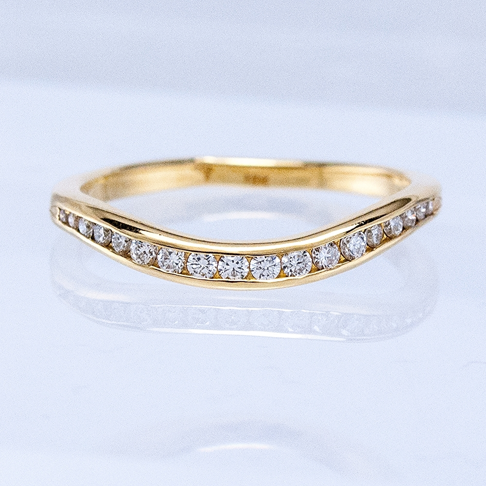 Curved Channel Band- yellow gold with diamonds
