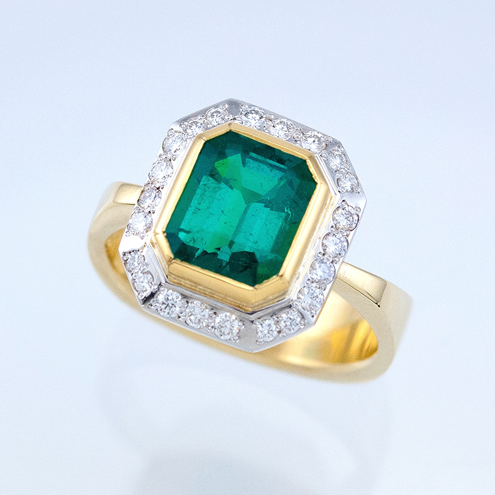 Modern Halo Ring with Octagonal Emerald