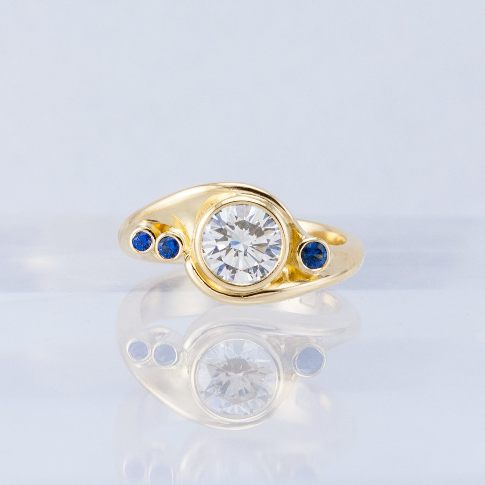 Windswept Ring with Diamond and Blue Sapphires
