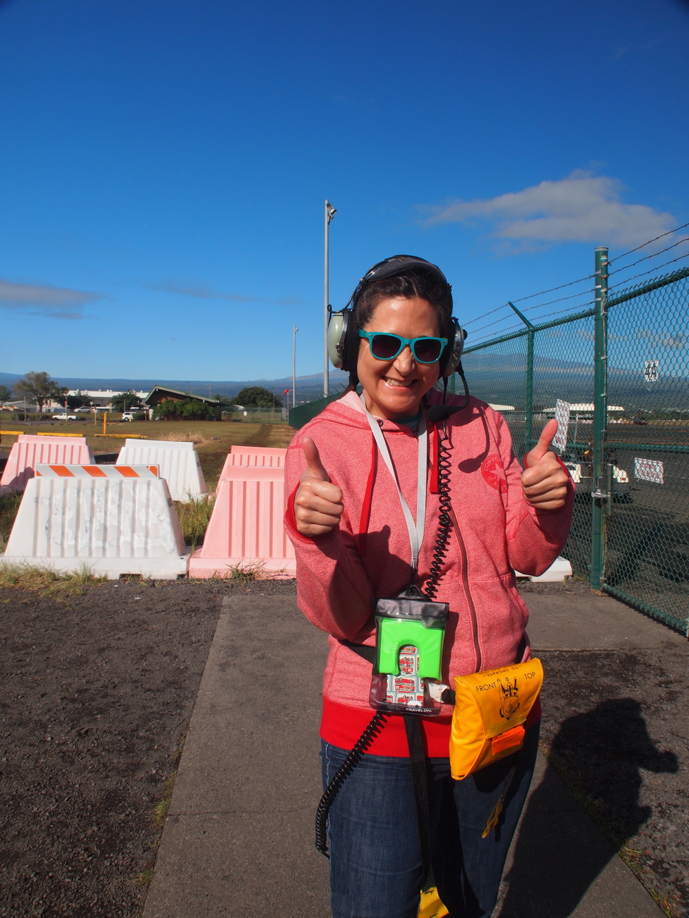 Getting ready for a helicopter ride. No doors, over a volcano. Yes please!
