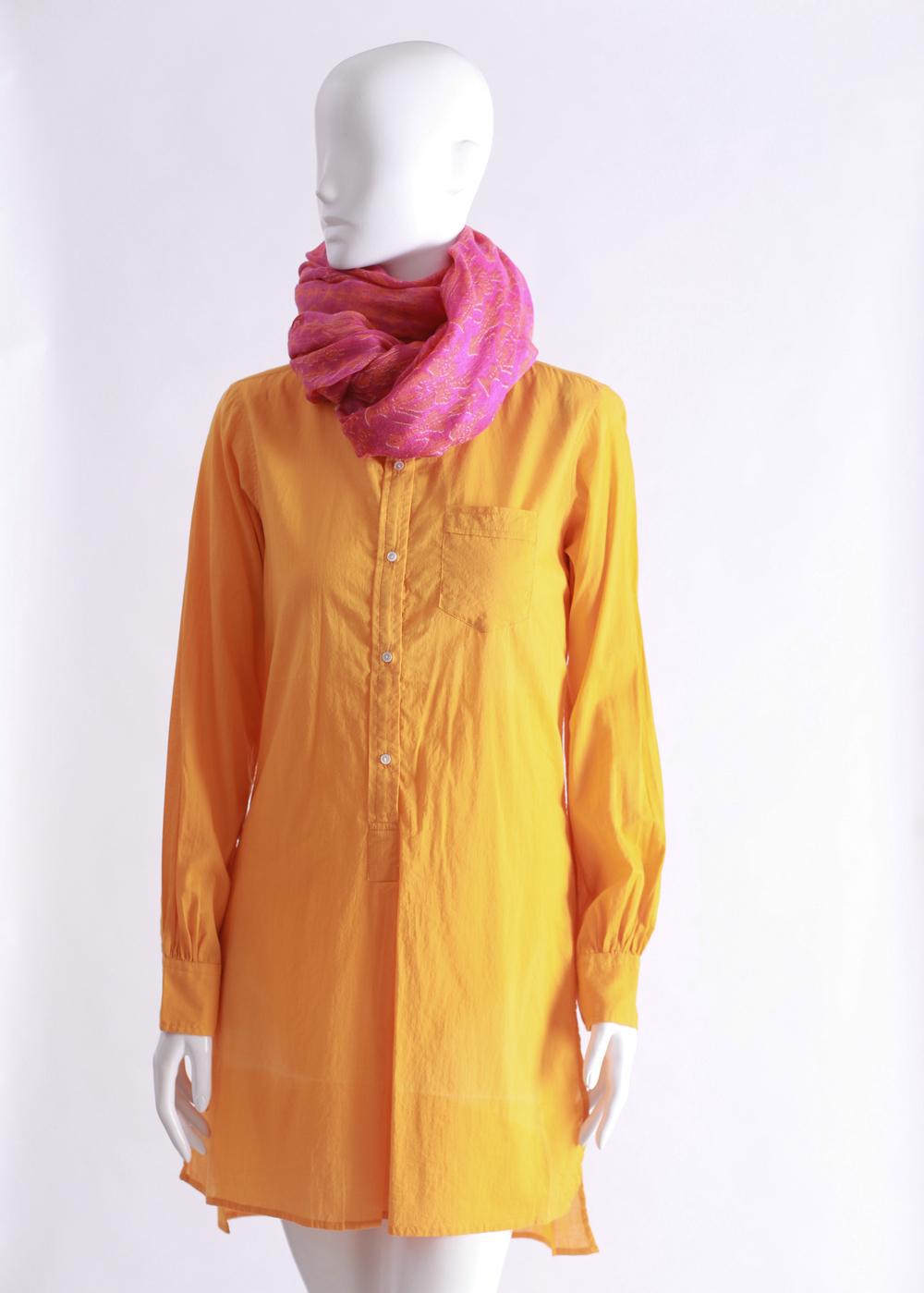 Nili Lotan orange tunic,paired with a Bajra cashmere scarf.