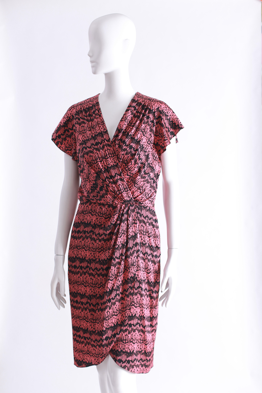 Veronica Beardpink andblack silk wrap dress.