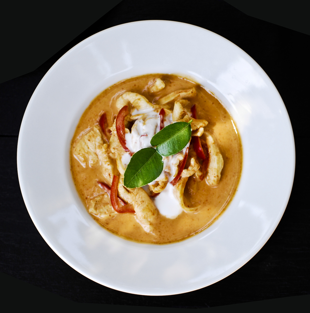 Panang Red Thai curry paste in coconut milk base, bell peppers, Kaffir lime leaves.