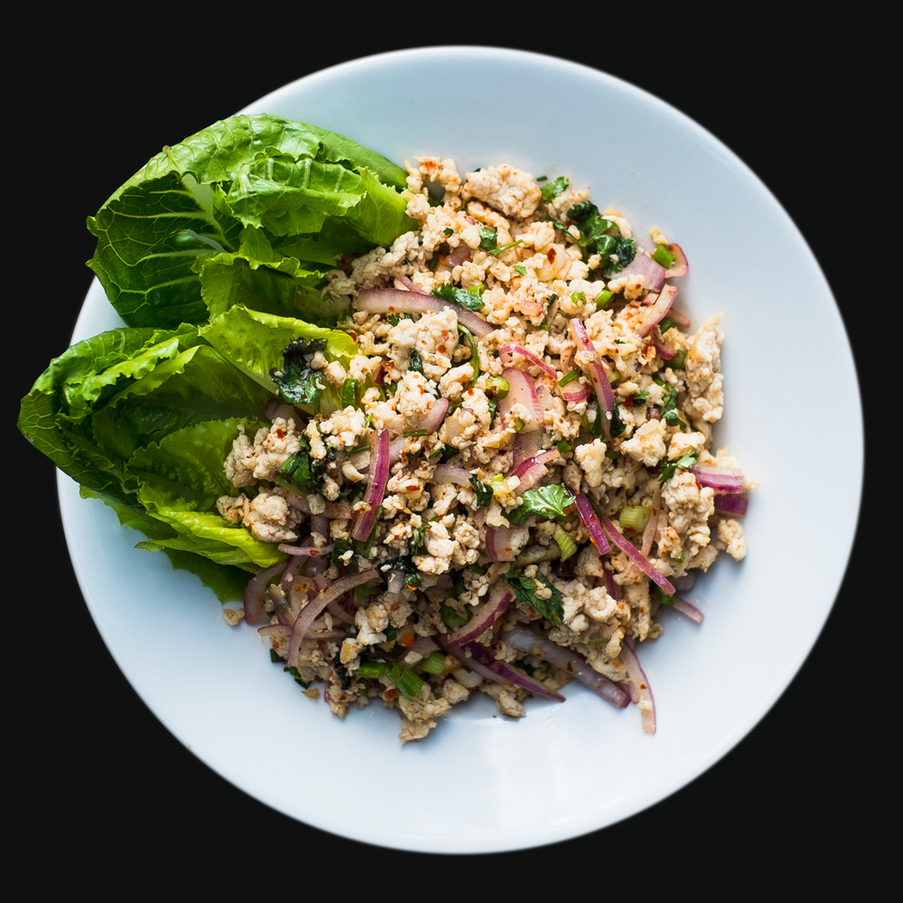 Larb Gai  Ground chicken, onion, cilantro, dry chili, Thai herbs, rice powder, lime juice. Served with heart of romaine.