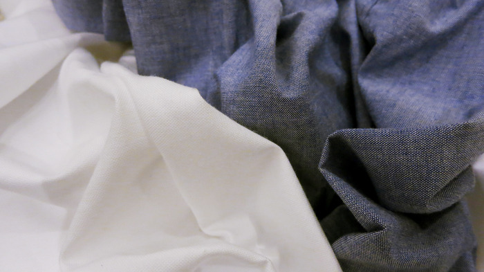 These shirts are made from 100% cotton, white oxford and blue chambray fabrics. They are produced right here in the United States from cottonseed to the loom.