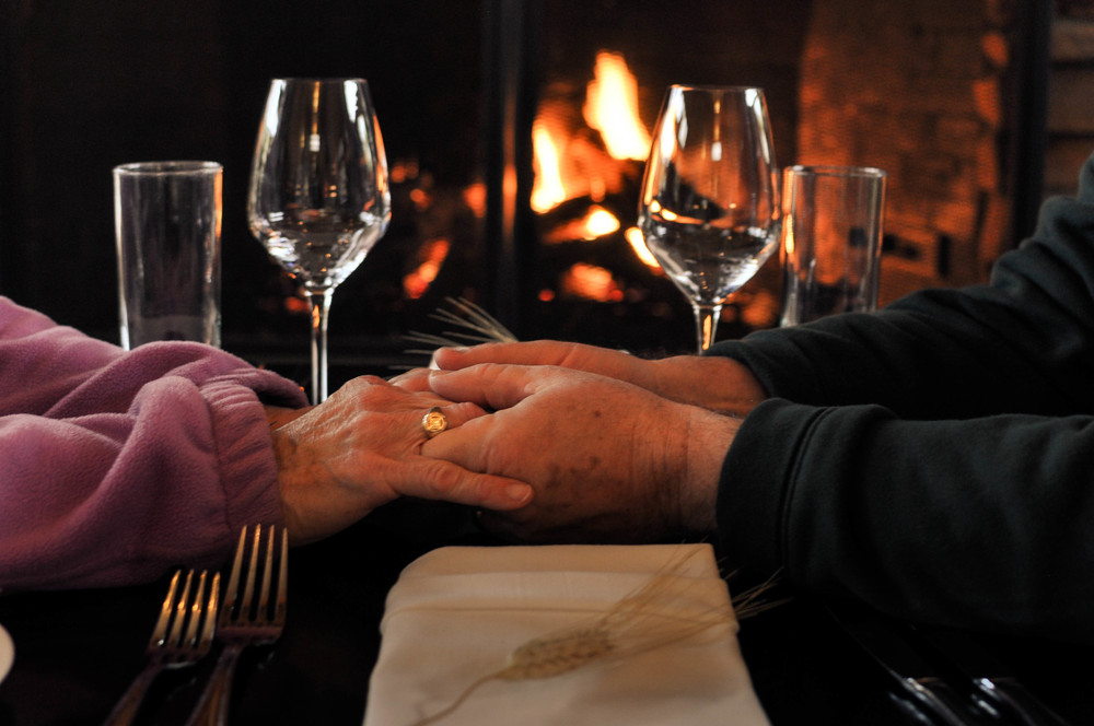 older couple hands fireplace ed 1.jpg