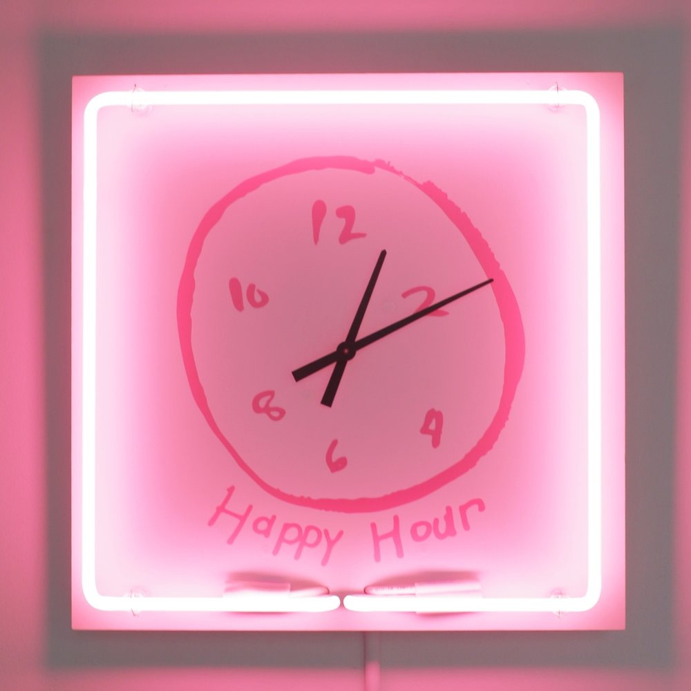 Happy Hour Clock , 2018  Clock face and neon mounted to powder-coated board  18 x 18 x 3 inches  The centerpiece of the  Rosé Room , Hovnanian's  Happy Hour Clock  runs in hyperspeed. The clock hits 5:00 pm at least once an hour - happy hour is never that far away. The neon border pays a nod to bar signs, casting a pink glow on the wall of drawings that feature icons and aftermaths of American drinking culture.