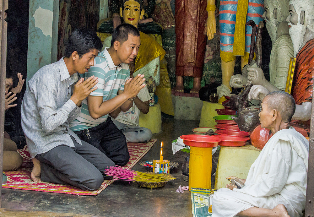 Prayer at Buddhist shrine, near Battambang, Cambodia