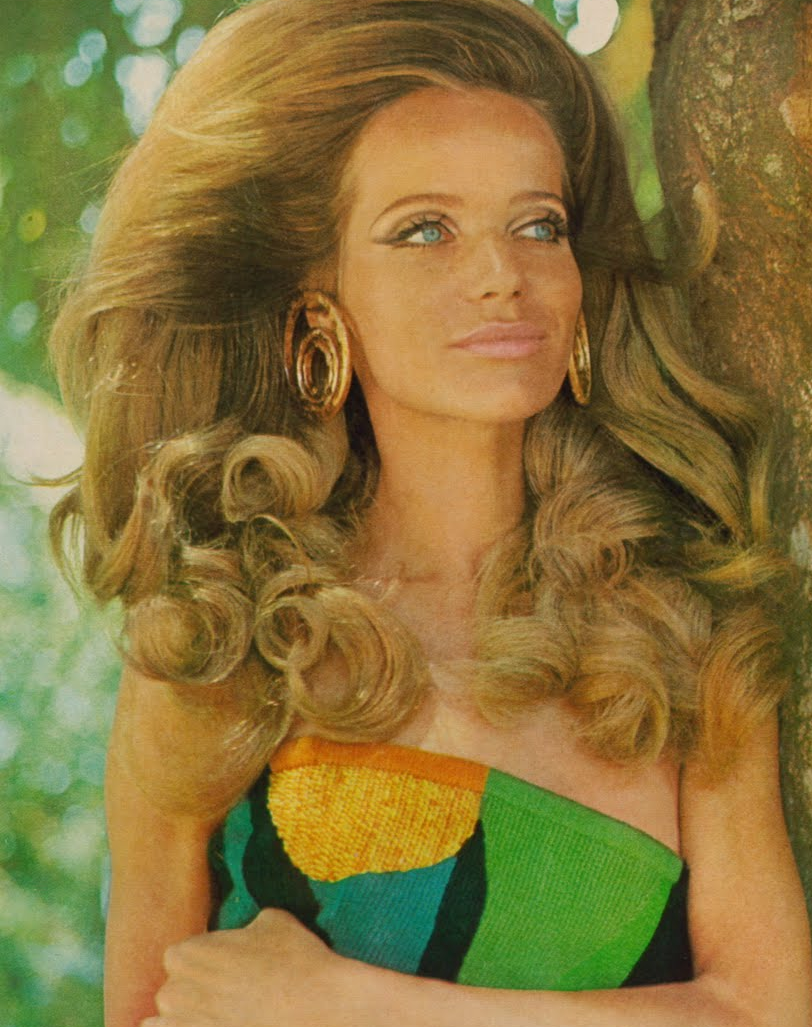 Clearly Veruschka is winning in the big hair stakes.