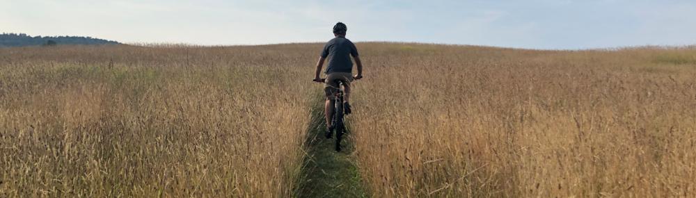 Mountain biking along a trail at  Woodsom Farm .