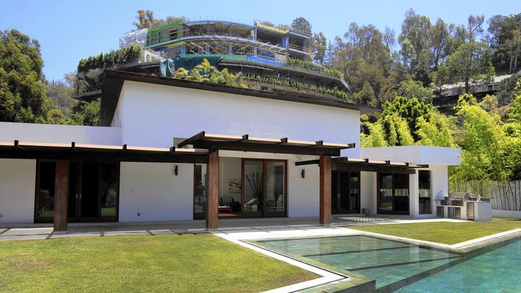 "Joseph Horacek III's home is being overshadowed by what he calls the ""Starship Enterprise"": a 30,000-square-foot mansion. Besides the visuals, Horacek is afraid the whole thing will come sliding down the hill. (Francine Orr / Los Angeles Times)"