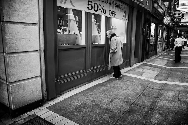 Elderly Woman Looks In a Store