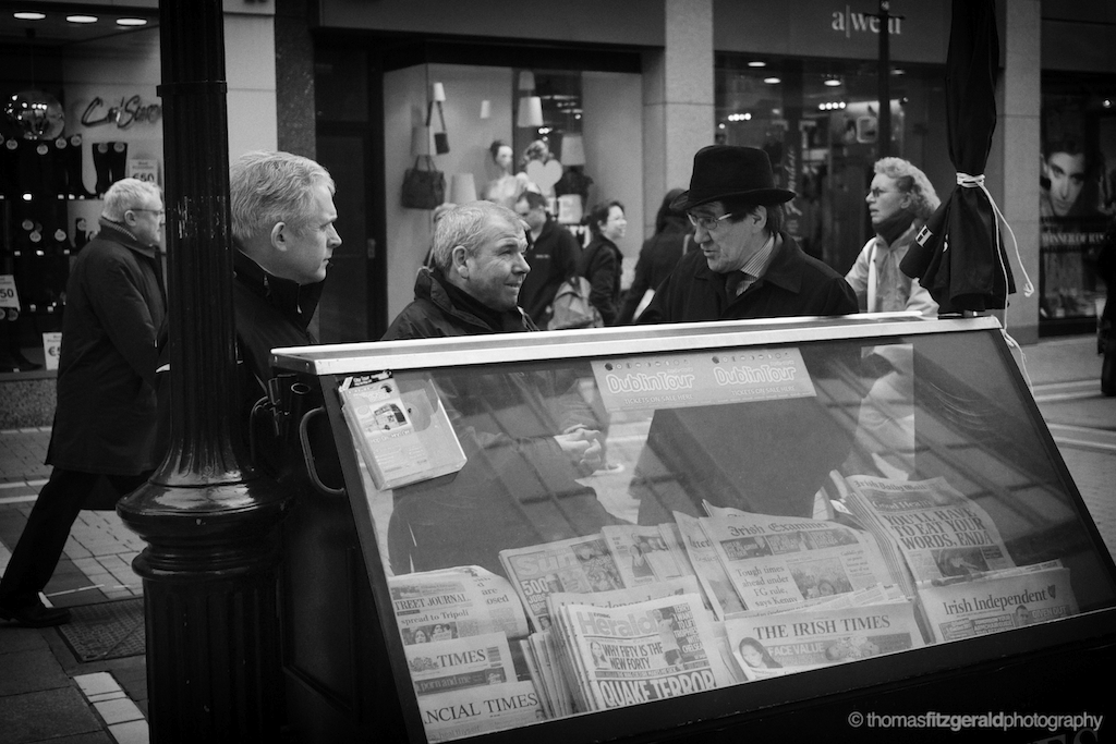 Discussing the news of the day at a news stand on Grafton Street