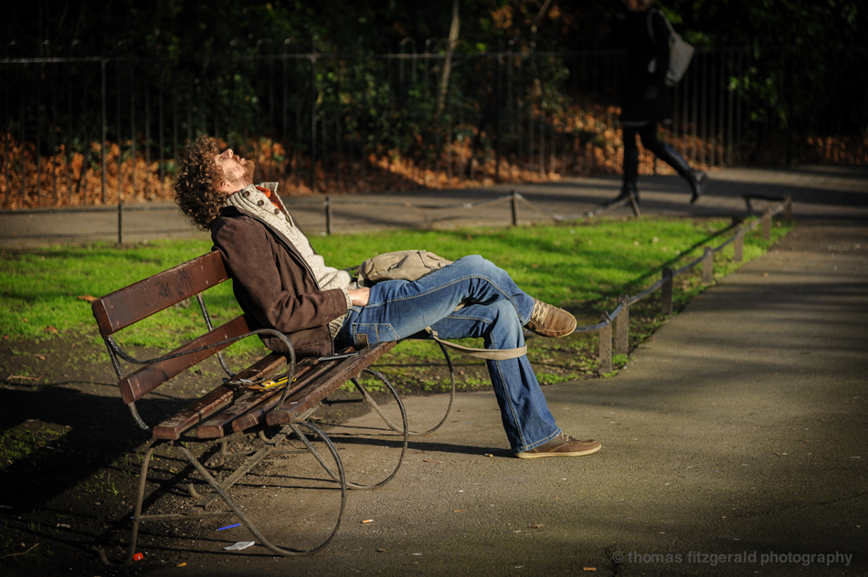 Guy Sleeping On a Bench