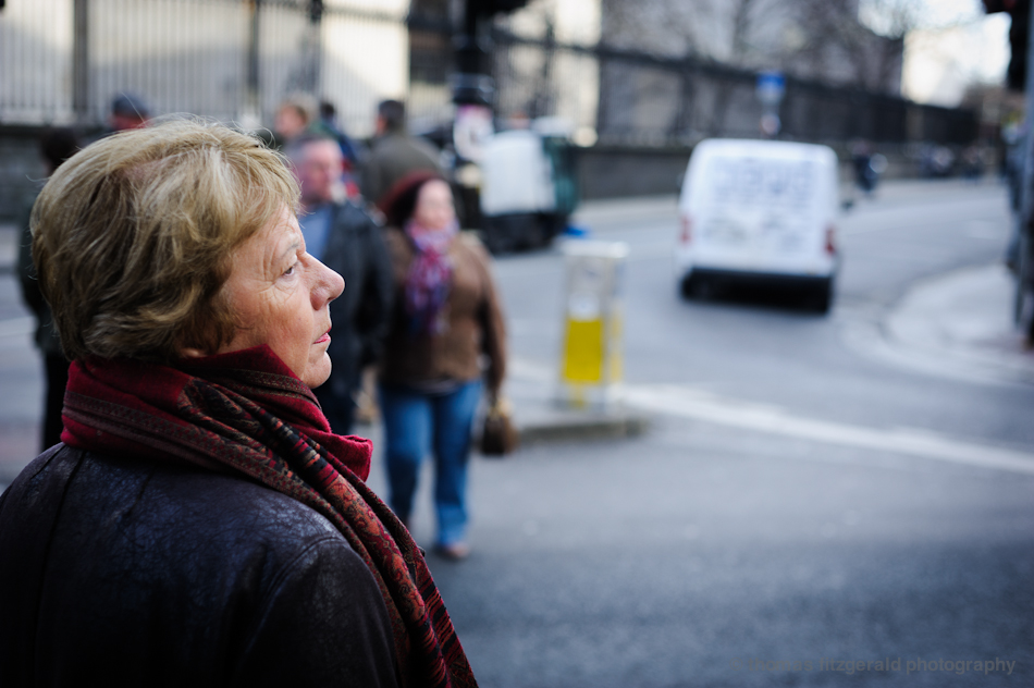 Woman Waits to Cross The Road