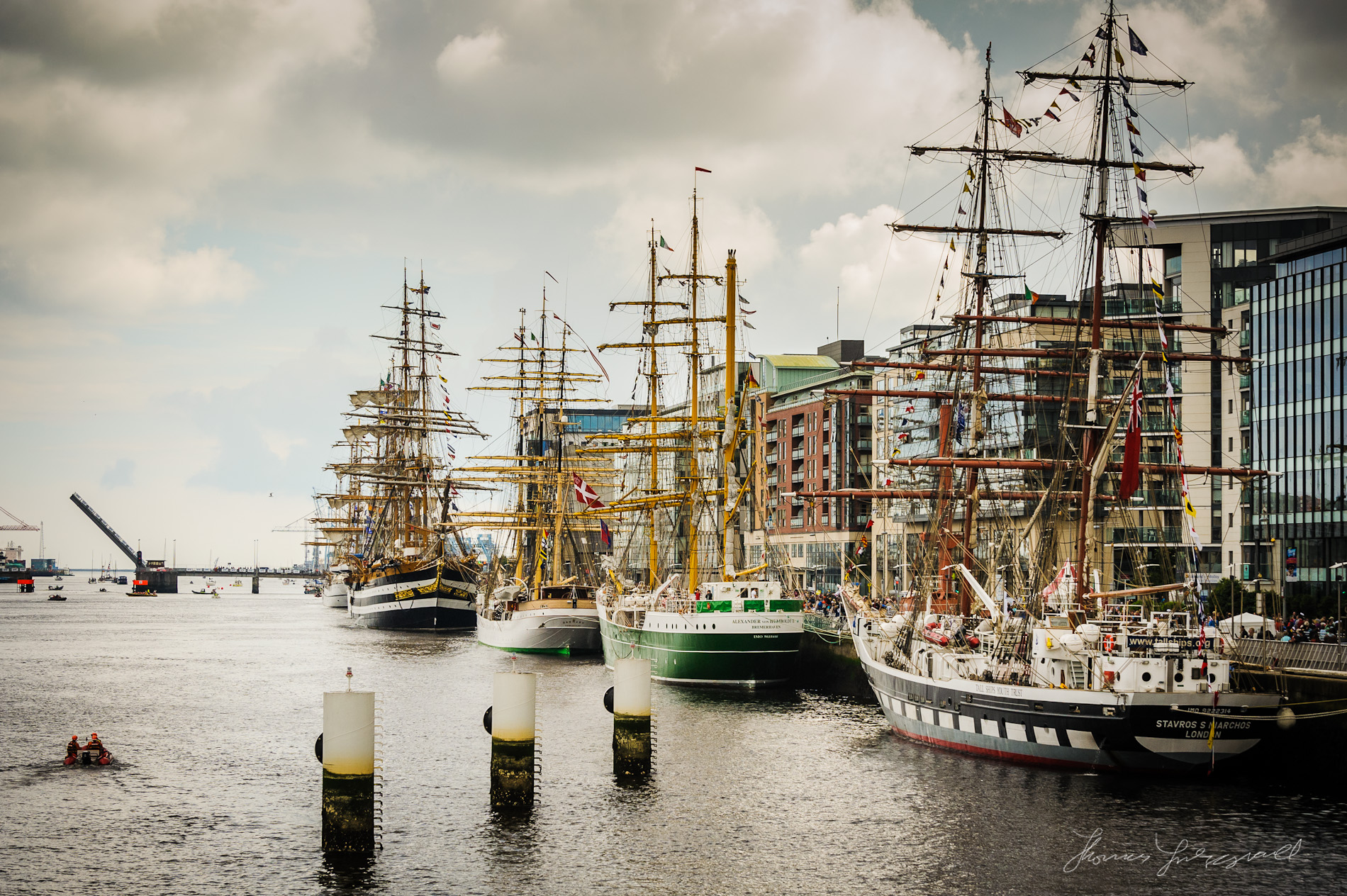 Tall Ships docked at the quay side on the river Liffey
