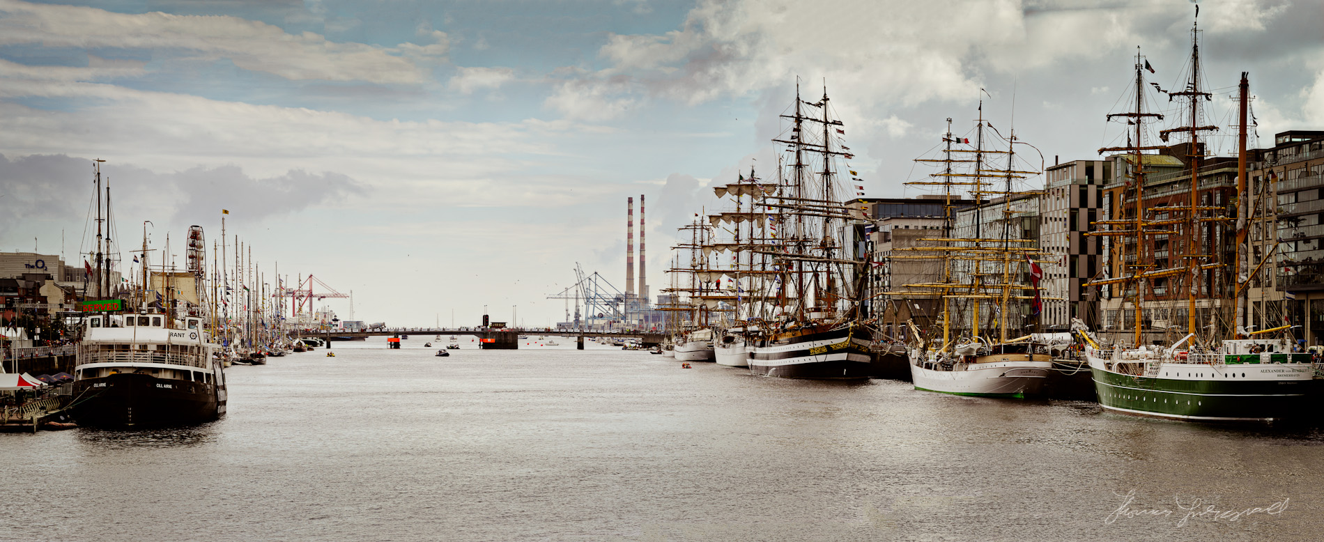 A Panorama of Dublin Harbour with ships taking Part in the Tall Ships festival berthed on the Side