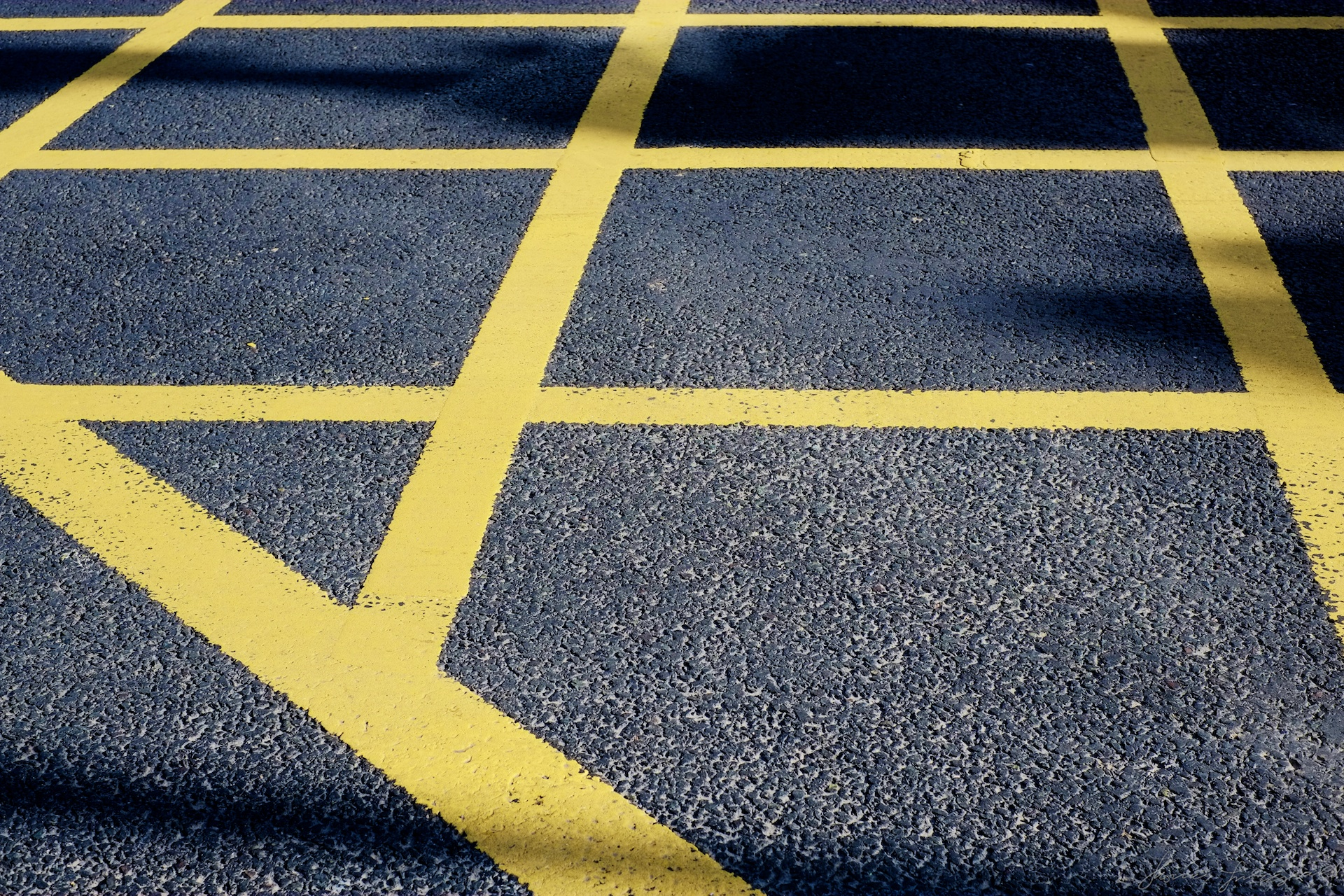 Yellow Lines on a black tarmac road
