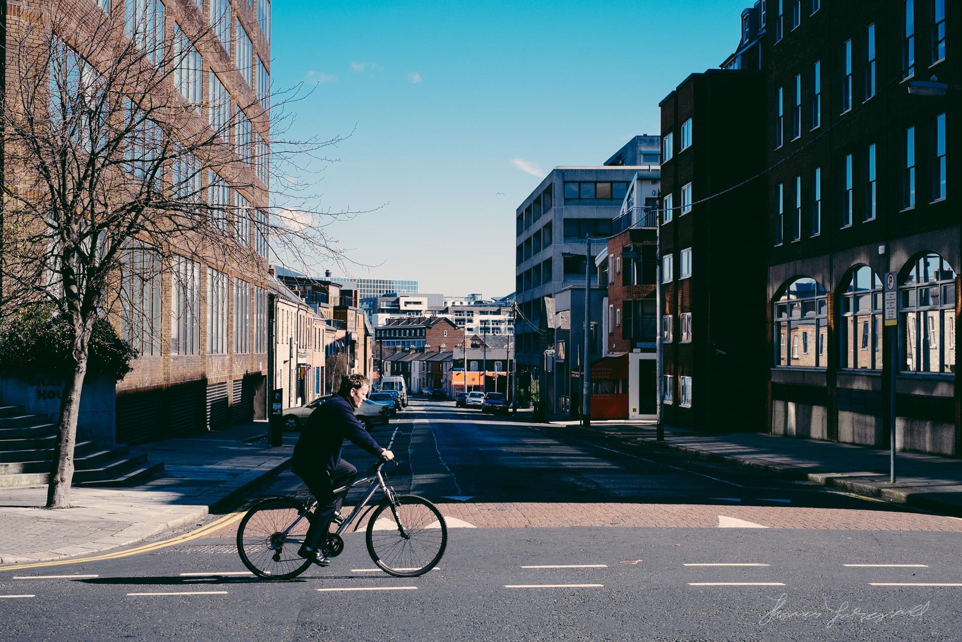 Man Walking By Empty Street